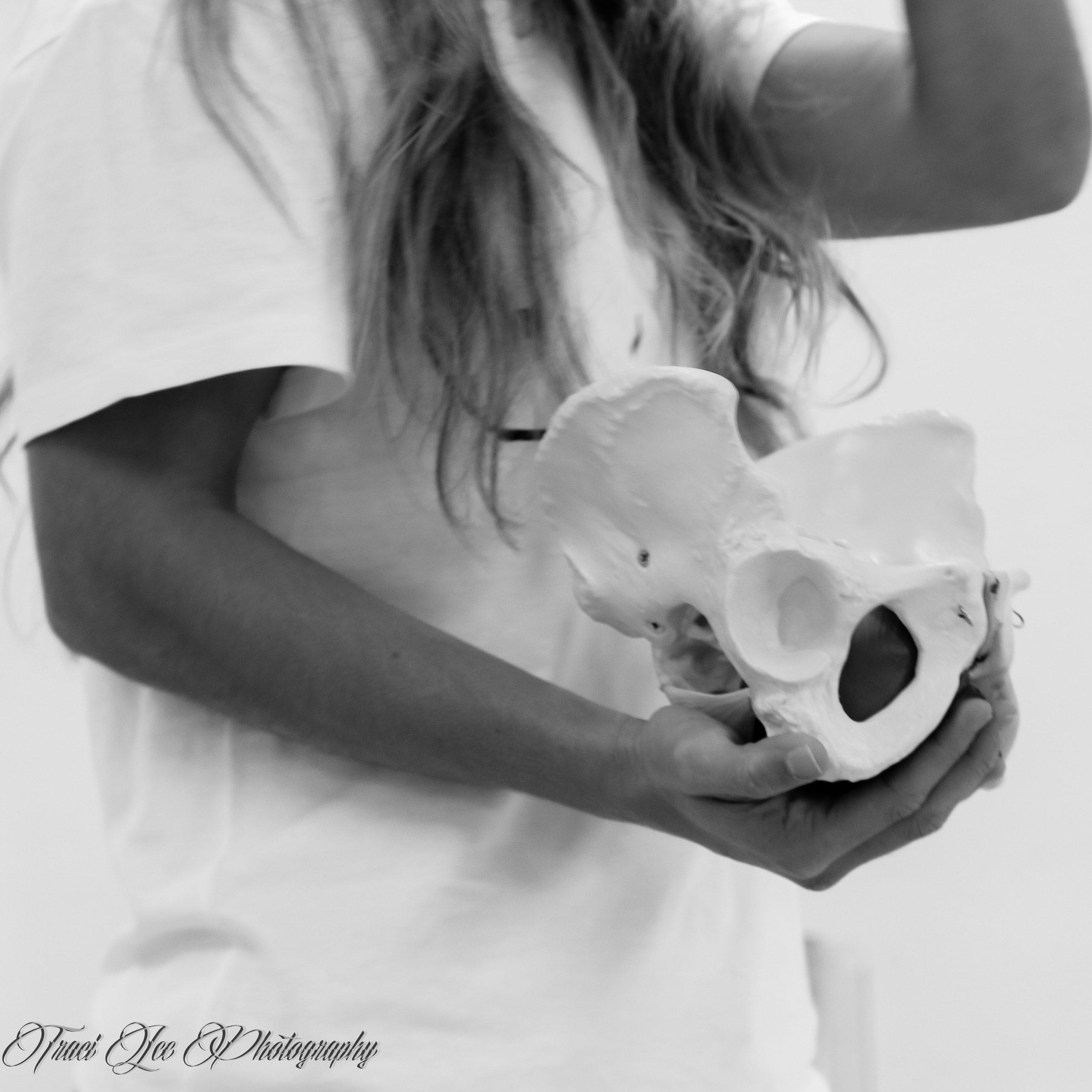 Image of a Woman Holding Pelvic Skeleton