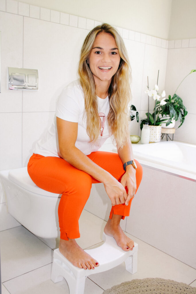 Woman Sitting on the Toilet